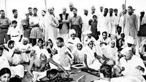 Gandhi and Jawaharlal Nehru spinning, Delhi.(National)