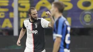 Juventus' Gonzalo Higuain celebrates after scoring his side's second goal.(AP)
