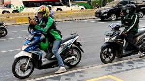 Bike taxis are a popular and inexpensive way to negotiate Jakarta's busy traffic(Sarit Ray)