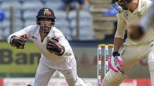 India's wicket-keeper Wriddhiman Saha dives to take a catch.(PTI)