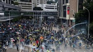 Anti-government protesters run away from tear gas during a demonstration in Wan Chai district in Hong Kong.(REUTERS Photo)