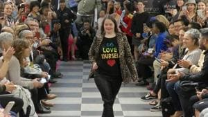 """This image from video taken on Wednesday, Oct. 16, 2019 shows a girl participating in the 2nd annual """"Gigi's Playhouse Fashion Show"""" in New York. Gigi's Playhouse is an education and achievement center that prepares young people with Down syndrome to engage more fully in their homes, schools and communities. (AP Photo/Gary Gerard Hamilton)(AP)"""