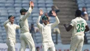 The South African team celebrates Rohit Sharma's wicket.(Pratham Gokhale/HT Photo)