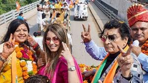 Bollywood actors Asrani and Mahima Choudhary during a roadshow in support of BJP candidate Kavita Jain in Sonepat on October 19