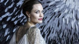 Actress Angelina Jolie poses for photographers on arrival at the European premiere of the film Maleficent Mistress of Evil in central London.(Grant Pollard/Invision/AP)