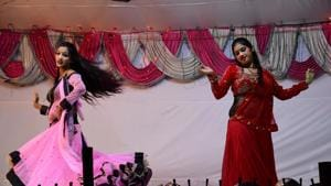"""(The girls earn between Rs 500 to Rs 1,000 per day. They live in tents behind the stage for 10 days during Ramleela. """"For the rest of the year, we dance at jaagrans and weddings. There are loans to be paid off, children to be fed. We set up tents near the venue. Isko party lagana kehte hain (We call it setting up a party),"""" says Aarti.)"""
