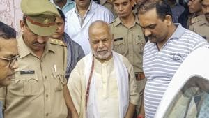 Former Union minister Swami Chinmayanand, accused of rape by a law student, as seen outside a government hospital after a medical examination following his arrest by a special team of Uttar Pradesh police.(PTI photo)
