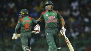 Bangladeshi batsmen Soumya Sarkar, right, and Mohammad Mithun run between wickets.(AP)