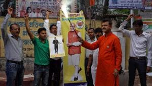 Supporters of India's ruling Bharatiya Janata Party (BJP) celebrate what they claim Indian army's strike on