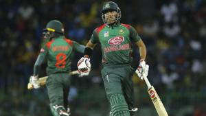 Bangladesh batsmen Soumya Sarkar, right, and Mohammad Mithun run between wickets.(AP)
