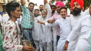Congress supporters celebrate a party candidate's win in the Assembly election in Karnal on Thursday.(Photo: PTI)