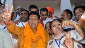 BJP's Gian Chand Gupta celebrating his victory in Panchkula.