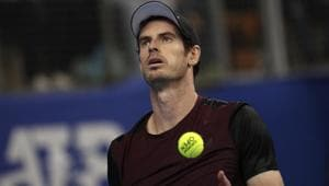 Andy Murray of Britain gets ready to serve to Stan Wawrinka of Switzerland.(AP)