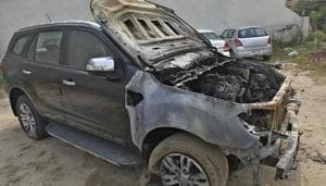 The damaged Ford Endeavour SUV parked in Haibowal in Ludhiana on Tuesday.(Gurpreet Singh/HT)