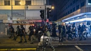 Riot police march along Des Voeux Road Central during a protest in the Sheung Wan district of Hong Kong.(Bloomberg Photo)