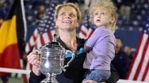 Kim Clijsters of Belgium and daughter Jada pose with the championship trophy.(Getty Images)