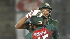 Bangladesh cricket team captain Mahmudullah, behind, celebrates with his team member Mushfiqur Rahim after wining first T20I.(AP)