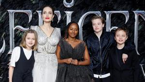 Actor Angelina Jolie, accompanied by her kids, poses as she attends the UK premiere of Maleficent: Mistress of Evil in London, Britain.(REUTERS)