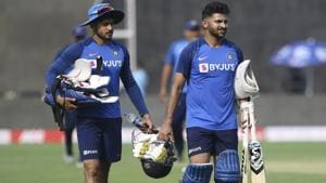Shreyas Iyer, right and Manish Pandey return after a practice session.(AP)