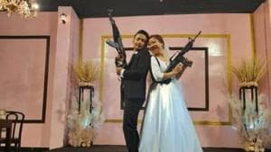 A young couple who posed with automatic assault rifles at their wedding reception in Nagaland's commercial hub Dimapur last week was arrested on Wednesday. They were later released on bail.(HT Photo)