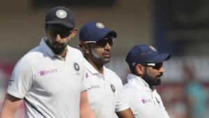 Indian players Ishant Sharma, left, Ravichandran Ashwin, center, and Mohammed Shami leave the field.(AP)