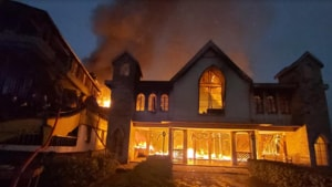 Fire engulfing the Church of Good building in Qualapatty area of Shillong on Sunday morning.(HT Photo)