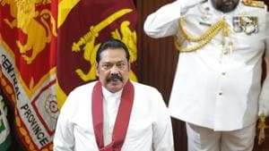 Sri Lanka's new Prime Minister Mahinda Rajapaksa stands for the national anthem at the presidential secretariat in Colombo, Sri Lanka on Thursday.(AP)