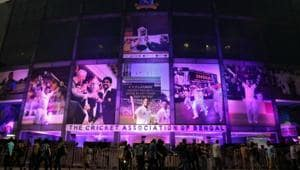 People move in front of Eden Gardens illuminated in pink on the eve of the first day-night test cricket match between India and Bangladesh(REUTERS)