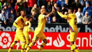 Barcelona's Arturo Vidal celebrates scoring their second goal.(REUTERS)