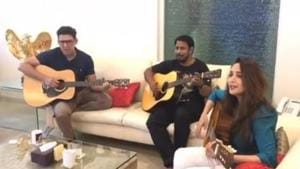 Madhuri Dixit sings and plays guitar at a family gathering.