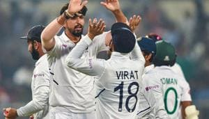 Kolkata: Indian bowler Ishant Sharma celebrates with skipper Virat Kohli )(PTI)