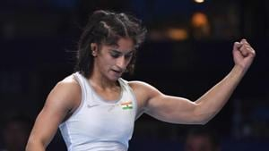 Vinesh Phogat of India reacts as she won the bronze match of the women's 53kg category.(AP)