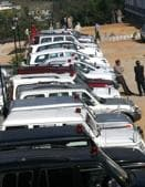 Government vehicles with red beacons parked outside the Dharamshala Vidhan Sabha.(HTfile photo)