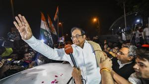 Senior Congress leader P Chidambaram waves at party workers and supporters after he was released from Tihar jail in New Delhi, Wednesday night, Dec. 4, 2019.(PTI)