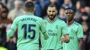 Real Madrid's Karim Benzema, center, celebrates after scoring.(AP)
