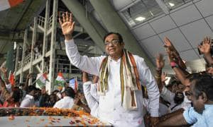 Congress leader P Chidambaram waves at party workers as he arrives at Chennai airport(PTI Photo)