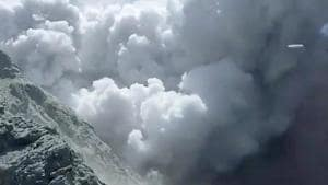 Thick smoke from the volcanic eruption of Whakaari, also known as White Island, is seen in New Zealand, December 9, 2019, in this image obtained via social media.(@SCH VIA REUTERS)