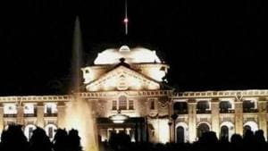 The illuminated main building of Allahabad High Court. The court, with 60 vacancies, tops the chart of high courts with the maximum number of vacant judges' posts.(PTI File)