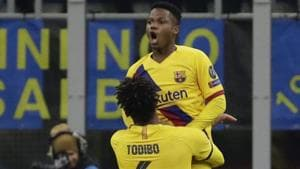Barcelona's Ansu Fati, up, celebrates after scoring his side's second goal.(AP)