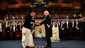 Indian-American economist Abhijit Banerjee shakes hands with Sweden's King Carl Gustaf as he receives the Economic Nobel at a ceremony in Stockholm, on December 10.(Reuters Photo)