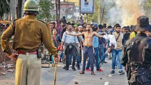 Protestors, amid tear-smoke clash with the police during their march against the Citizenship (Amendment) Bill, 2019, in Guwahati, Wednesday, Dec. 11, 2019.(Photo: PTI)