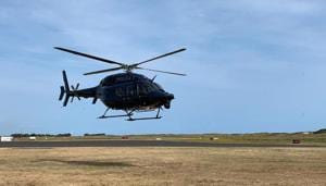 A New Zealand Police helicopter returns to Whakatane Airport after conducting a search for bodies in the aftermath of the eruption of White Island volcano, December 15, 2019.(New Zealand Police / Handout via REUTERS)