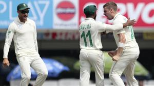 South Africa's captain Faf du Plessis, left, runs to celebrate with Anrich Nortje, right, the dismissal of India's captain Virat Kohli during the third and last cricket test match between India and South Africa.(AP)