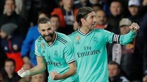 Real Madrid's Karim Benzema celebrates scoring their first goal with Sergio Ramos(REUTERS)