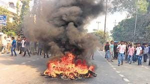 Tyres burn as protests rage in Guwahati, Assam against the Citizenship Amendment Bill (CAB) during the 11-hr northeast shutdown called on December 10 by North East Students Organisation (NESO).(HT Photo)