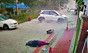 A CCTV grab showing the victim and the car that hit her at Rajguru Nagar in Ludhiana.(HT PHOTO)