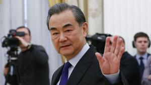 China's top diplomat Wang Yi waves during a meeting with Russia's President Vladimir Putin at the Kremlin in Moscow in this file photo.(Reuters Photo)