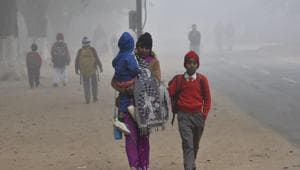 Students on a way to school during a cold and foggy morning(HT File)