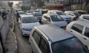 Vehicles stuck in a traffic jam at Bharat Nagar Chowk in Ludhiana on Sunday.(HT PHOTO)