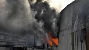 Firefighters trying to control fire at SK Bikes, Phase 7, Focal point area in Ludhiana on Thursday.(Harsimar Pal Singh/HT)